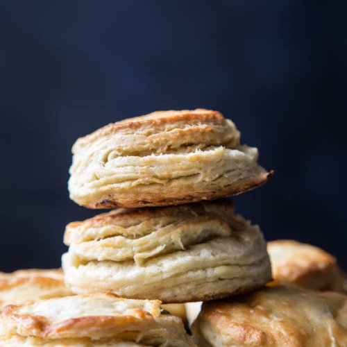 A stack of flaky buttermilk biscuits