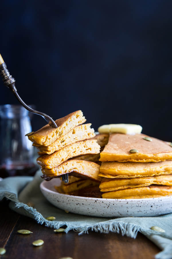 Buttermilk Pumpkin Pancakes with maple syrup drizzle
