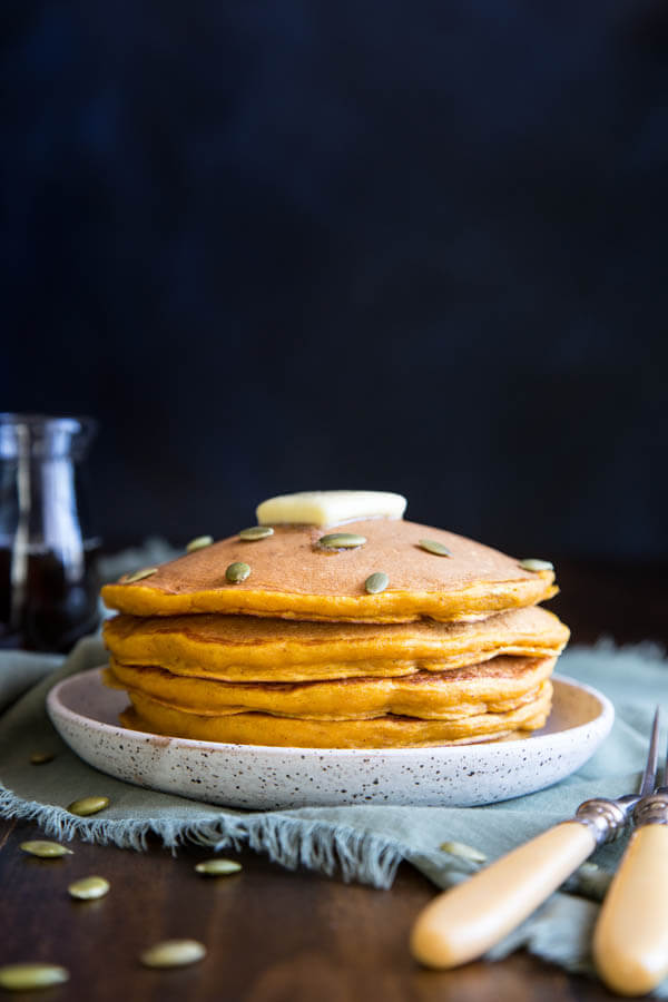 Buttermilk Pumpkin Pancakes with a dab of butter and maple syrup