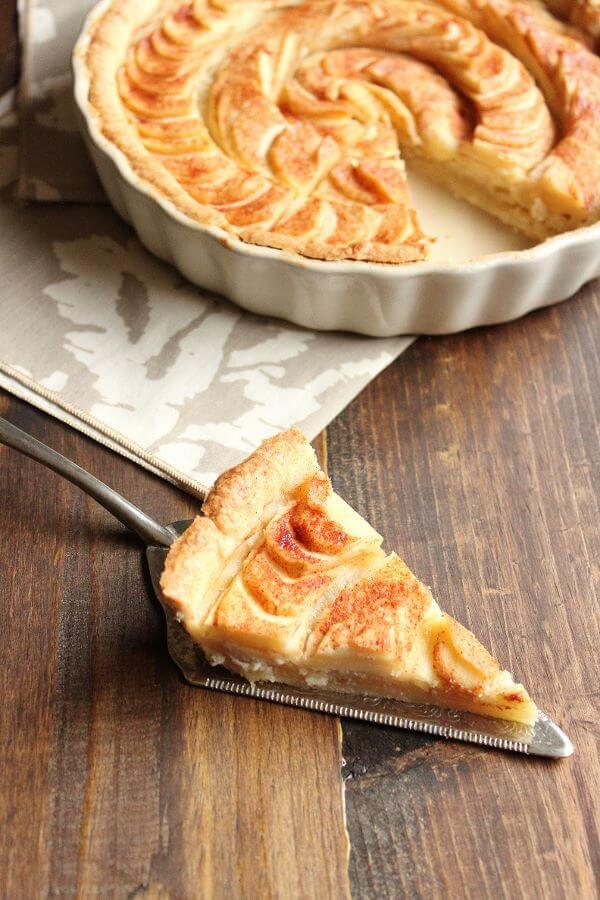 This Apple Tart has a hidden layer of delicious homemade almond paste underneath the apples. It is a wonderful dessert for Fall and will for sure be a hit at any of your holiday dinner parties. | wildwildwhisk.com