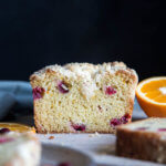 Orange Cranberry Bread on a cutting board