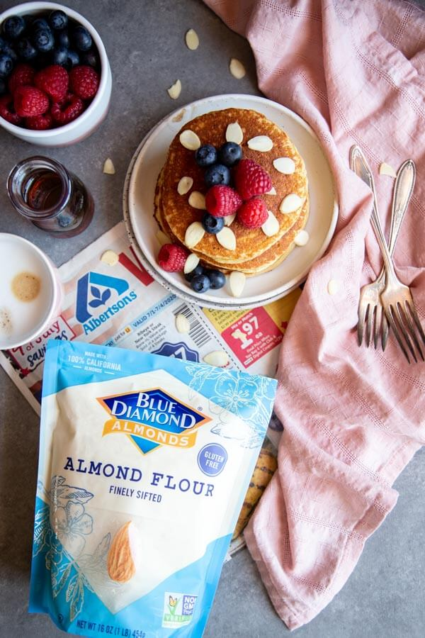 Almond Pancakes on a plate next to a bag of almond flour