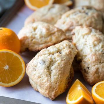 Orange scones on a baking trays with orange slices