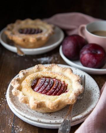 Mini plum tart on a plate