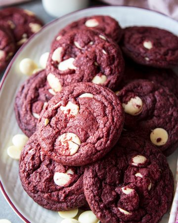 A batch of baked red velvet cookies on a platter