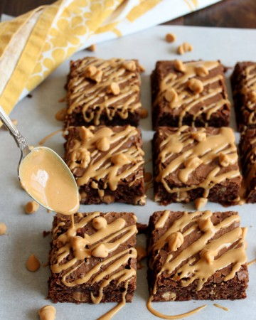 Peanut butter drizzling over Peanut Butter Brownies