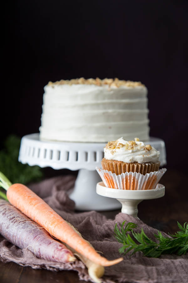 These Carrot Cupcakes are soft and moist, slightly spiced, with a little bit of crunch from the walnuts. And the cream cheese frosting takes the cake home! | wildwildwhisk.com