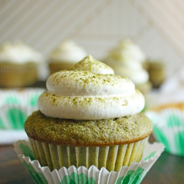 A Matcha cupcake with whipped cream topping