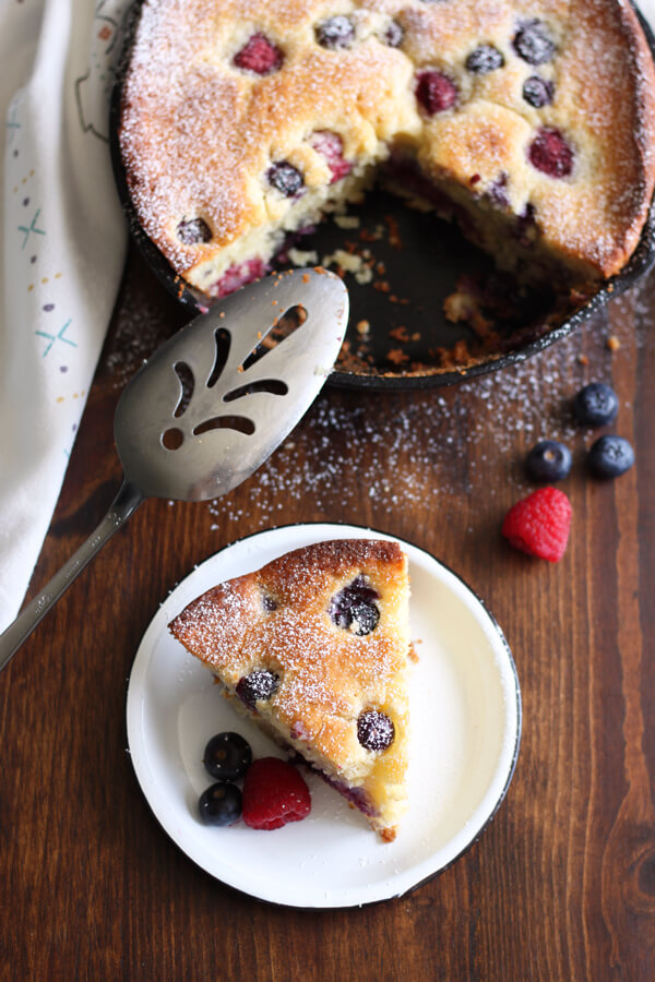 A slice of Mascarpone Mixed Berry Cake on a plate