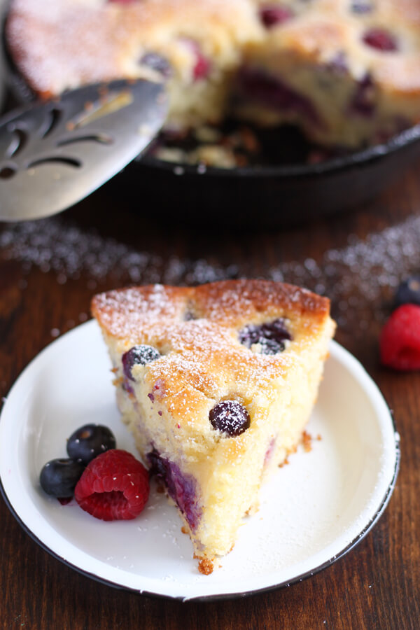 This Mascarpone Mixed Berry Cake is so soft and moist, it can be baked and served straight from the pan. The easiest cake recipe! | wildwildwhisk.com