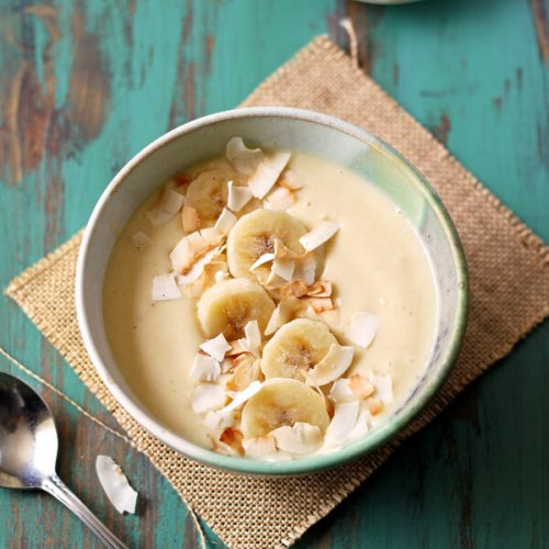 This easy Pina Colada Smoothie Bowl (minus the rum) is a healthy and tropical breakfast that will take you to the island in a spoon! | wildwildwhisk.com