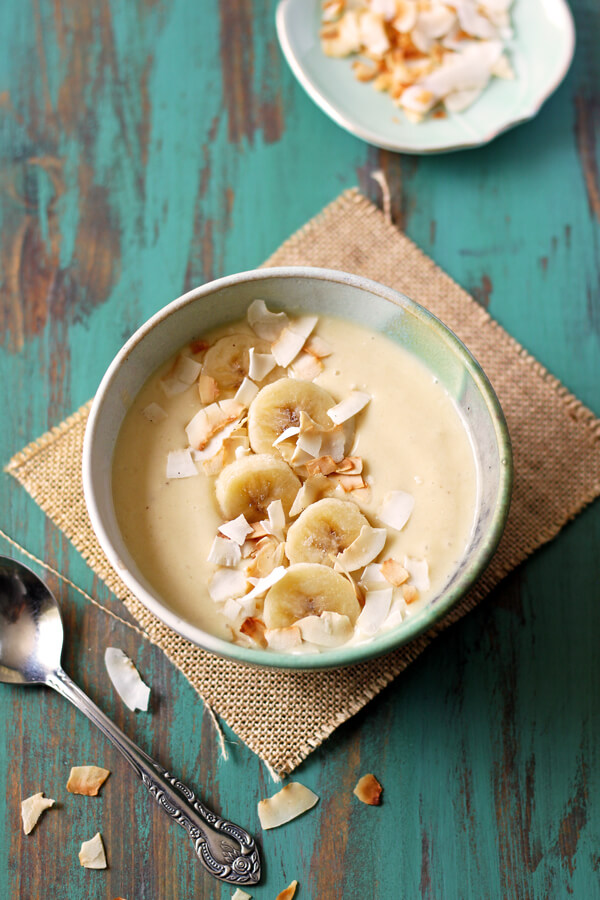 This easy Pina Colada Smoothie Bowl (minus the rum) is a healthy and tropical breakfast that will take you to the island in a spoon!   wildwildwhisk.com