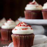 A red velvet cupcake with cream cheese frosting