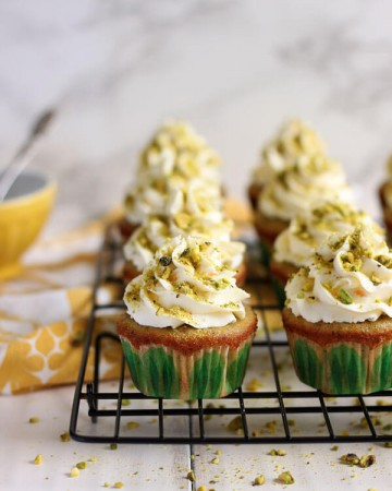 Pistachio cupcakes on a wire rack