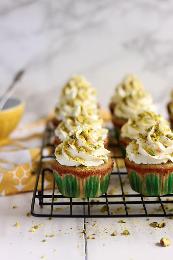 These Pistachio Cupcakes with Orange Mascarpone Frosting are made with real pistachio. The fluffy orange mascarpone whipped cream frosting adds a fresh citrus taste that pairs perfectly with these little bites of heaven. | wildwildwhisk.com