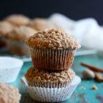 These Pumpkin Muffins with Pumpkin Pie Spice Streusel are packed full of pumpkin puree and warm sweet spices. Every single bite is bursting with the flavors of Fall. | wildwildwhisk.com
