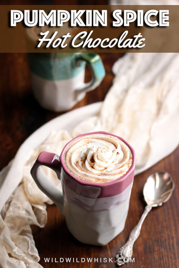This smooth and creamy Pumpkin Pie Hot Chocolate actually tastes like pumpkin pie! It is made with real pumpkin puree and homemade pumpkin pie spice. | wildwildwhisk.com