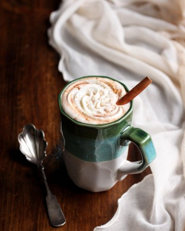 Pumpkin spice hot chocolate in a mug with whipped cream