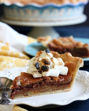 This S'mores Bomb Pie tastes like campfire s'mores on steroid. It is an intensely decadent dessert that will blow your mind! | wildwildwhisk.com