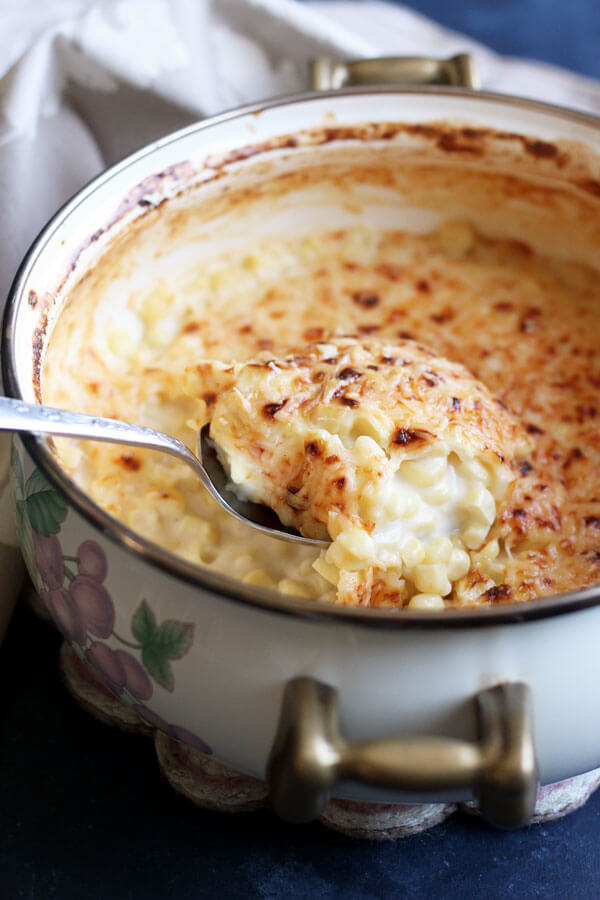 Creamed Corn au Gratin is a comforting sweet savory side dish that pairs well with both red meat and white meat, a perfect addition to your holiday menu. | wildwildwhisk.com