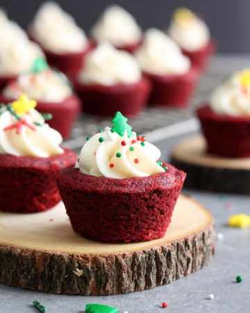 These cute little Red Velvet Cookie Cups are filled with luscious cream cheese frosting and decorated with festive Christmas sprinkles.