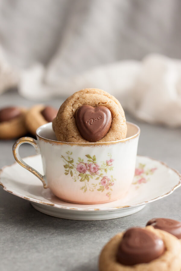 A peanut butter blossom cookie in a tea cup