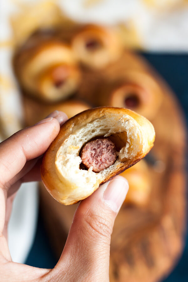 Piglets in Milk Bun Blankets are made with little beef smokies wrapped in homemade milk bread. These little Asian style pigs in a blanket will be the stars on your appetizer table at any party. | wildwildwhisk.com