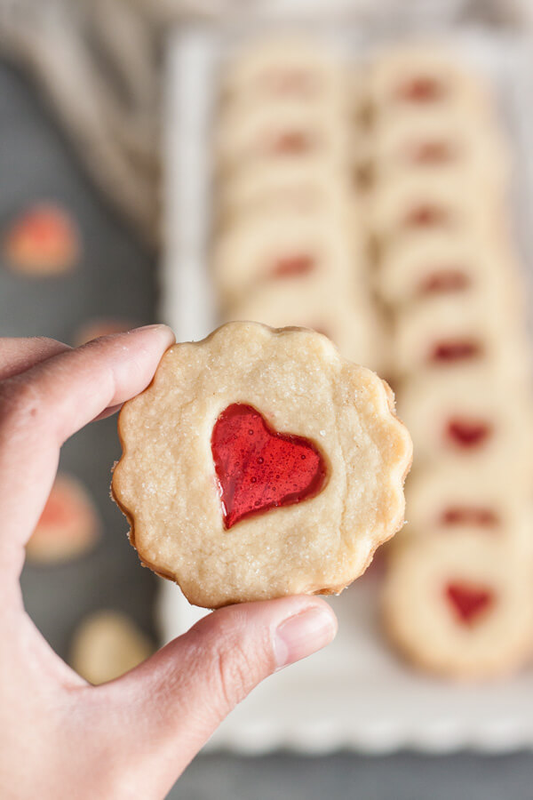 These Valentine's Day Stained Glass Shortbread Cookies are made with buttery shortbread and a hard candy center. They are perfect for gifting this Valentine's Day. | wildwildwhisk.com