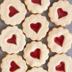 Shortbread cookies with red heart shaped stained glass windows