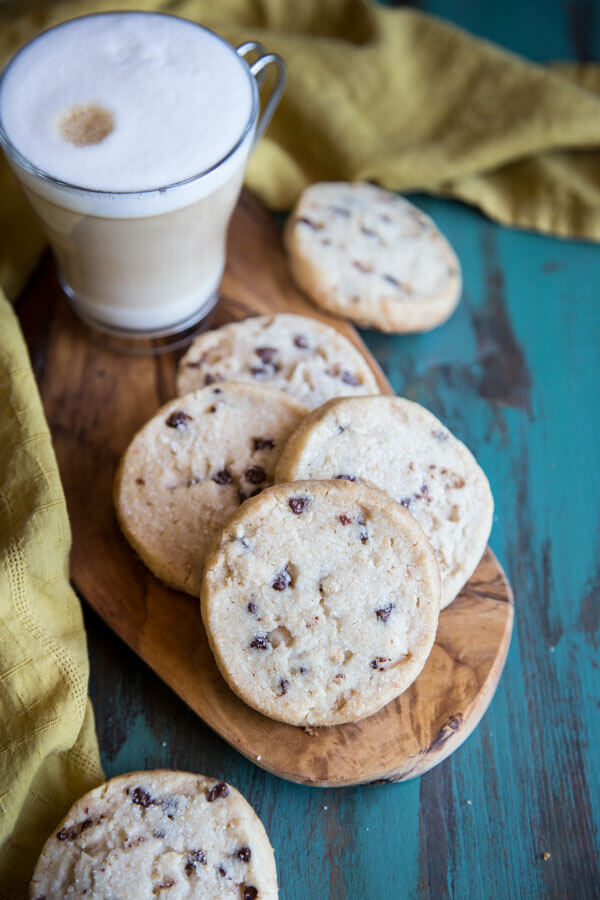 Chocolate chip shortbread on a small wooden board