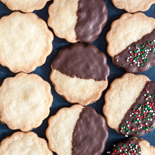 These Classic Shortbread Cookies can be served plain or covered in chocolate. Whichever way you decide to make them, they're always a crowd favorite, because classic never goes out of style. | wildwildwhisk.com #shortbread #SundaySupper