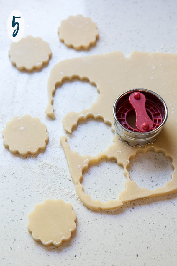 Cutting shortbread cookie dough with a cookie cutter