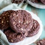Chocolate mint chip cookies on a white plate.