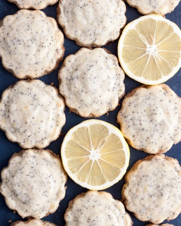 Lemon Poppy Seed Shortbread Cookies and lemon slices flat lay