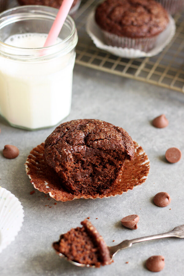 Chocolate Coconut Yogurt Muffins - one with a bite taken out