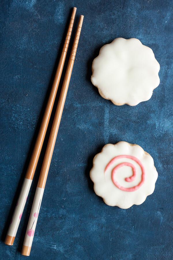 Narutomaki Shortbread Cookies next to a pair of chopsticks