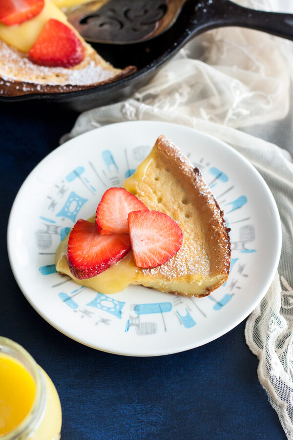 A Lemon Dutch Baby slice on a plate