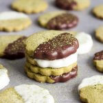 A stack of chocolate dipped Matcha Green Tea Shortbread Cookies