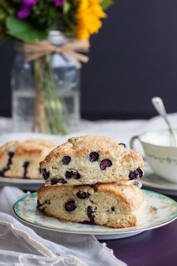 Lemon Blueberry Cream Scones stacked on a plate