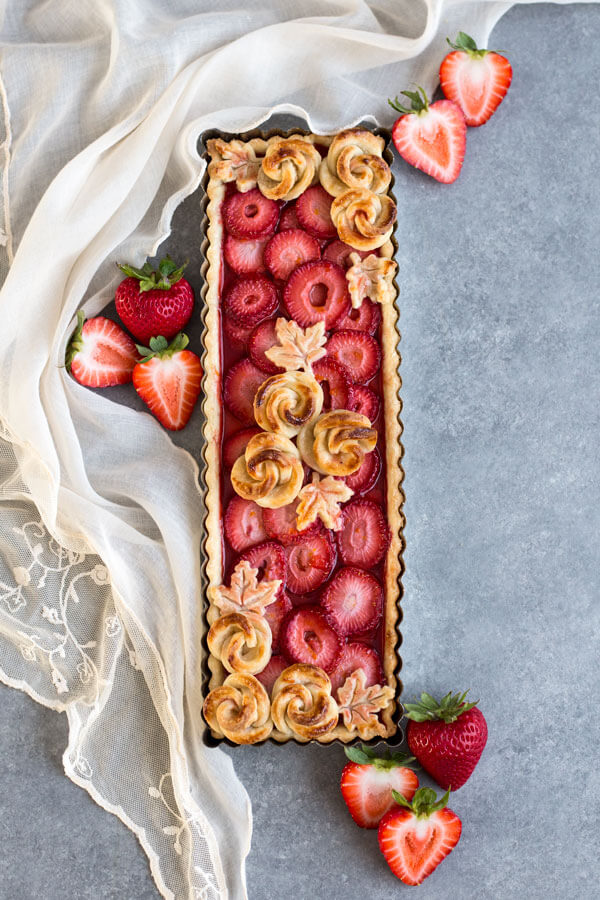 Fully baked and decorated Strawberry Rose Tart