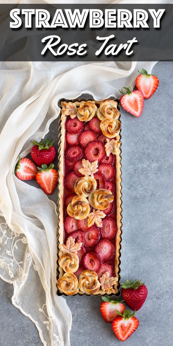 This gorgeous Strawberry Rose Tart is much easier to make than it looks. With a delicious orange strawberry filling, this tart is a dessert made to impress. | wildwildwhisk.com #strawberrytart #piecrustroses #strawberrypie