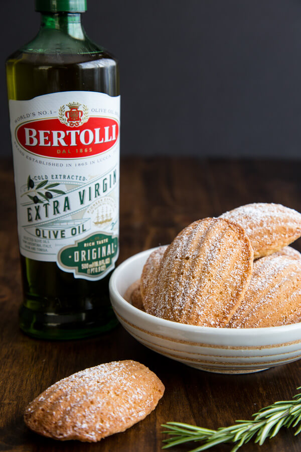 Olive Oil Rosemary Madeleines next to Bertolli EVOO bottle