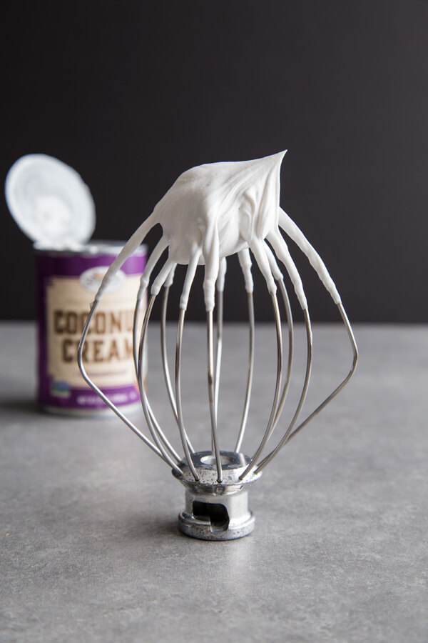 Coconut Whipped Cream forming stiff peak on a beater