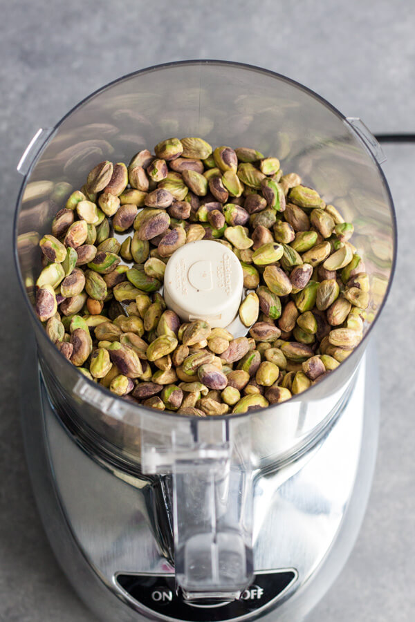 Pistachio in a food processor ready to be made into pistachio butter