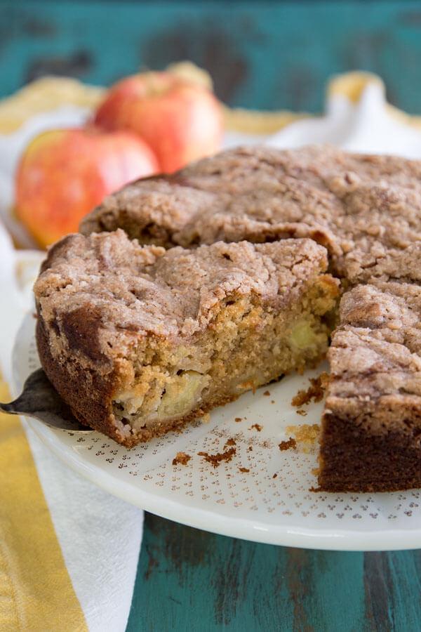 Cardamom Apple Coffee Cake on a cake stand
