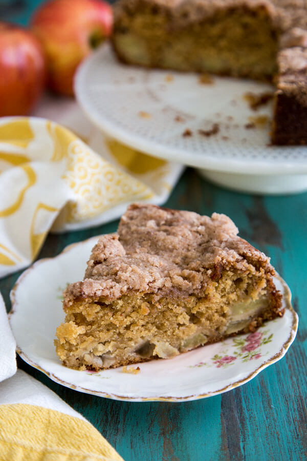 A slice of Cardamom Apple Coffee Cake on a plate