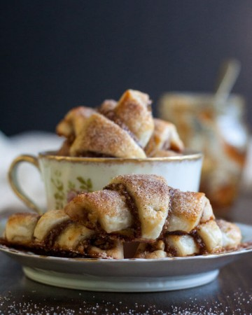 Fig Jam and Walnut Rugelach sitting in a tea cup and saucer