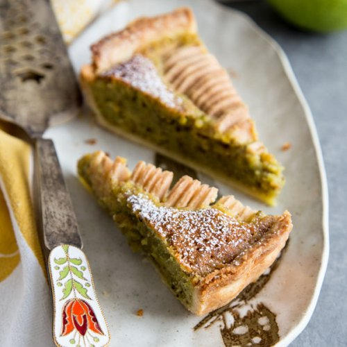 Pear Pistachio Frangipane Tart slices on a plate