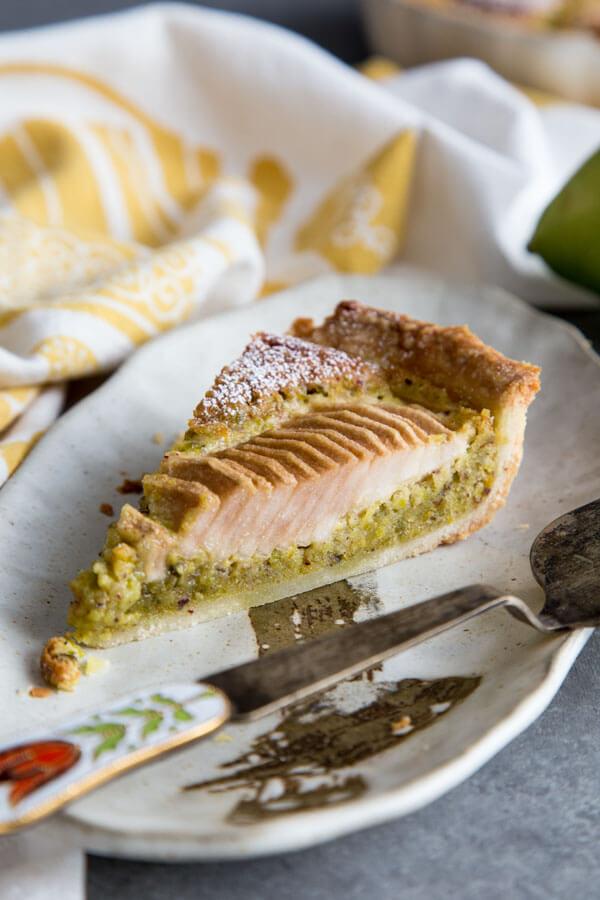 Pear Pistachio Frangipane Tart slice on a plate