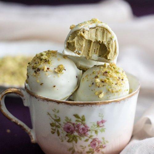 White Chocolate Pistachio Truffles in a tea cup